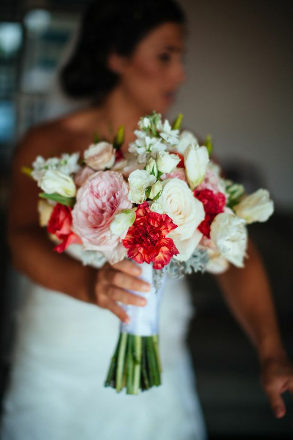 red, pink, and white wedding bouquet