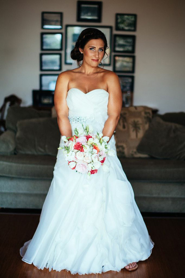 bridal beauty - strapless wedding gown and red accented bouquet