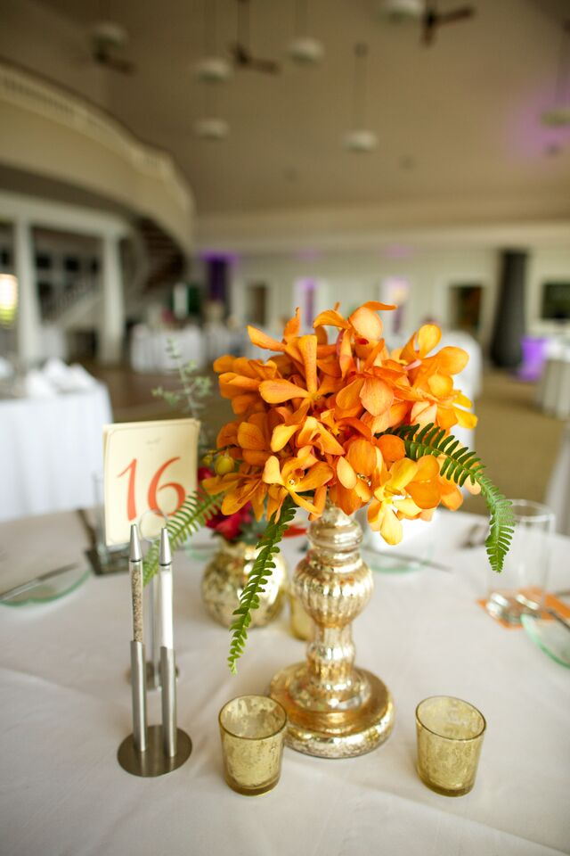 Gold and Orange wedding table display accents