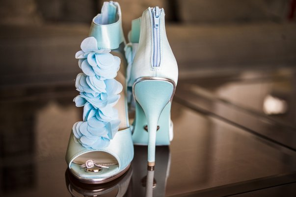 powder blue high heels and an engagement ring