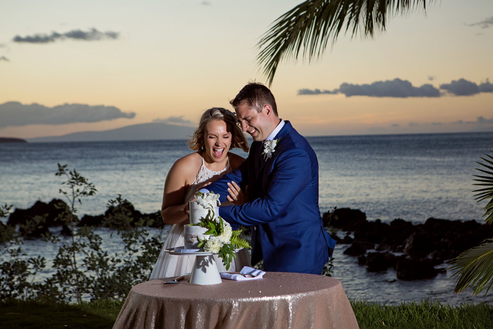 Just Mauid wedding cake cutting
