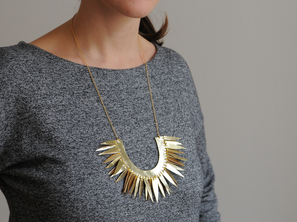 Handmade gold leather sun necklace