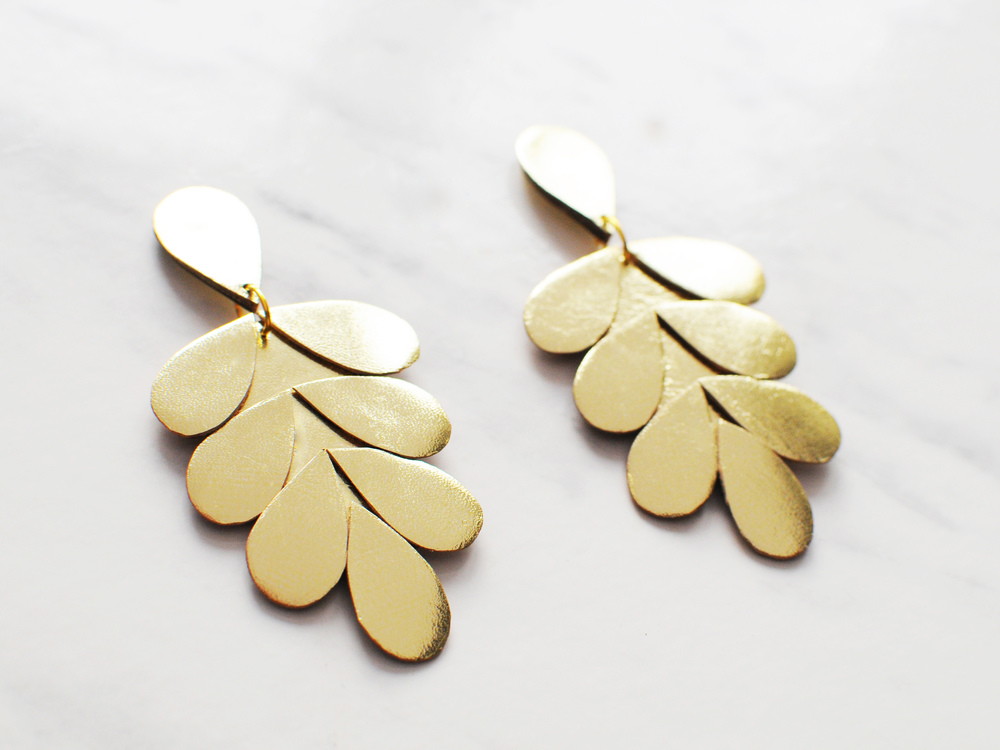 Handmade gold leather laurel leaf statement earrings
