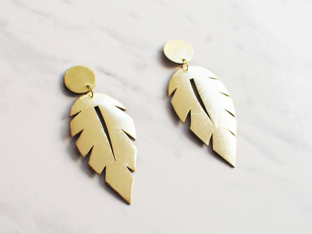 Handmade gold leather leaf cut out earrings