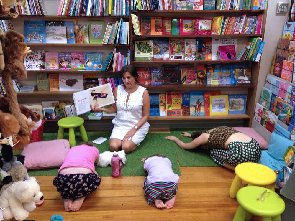 A little quiet time in child's pose at our  Making Mindful Magic  reading event at Books@Stones