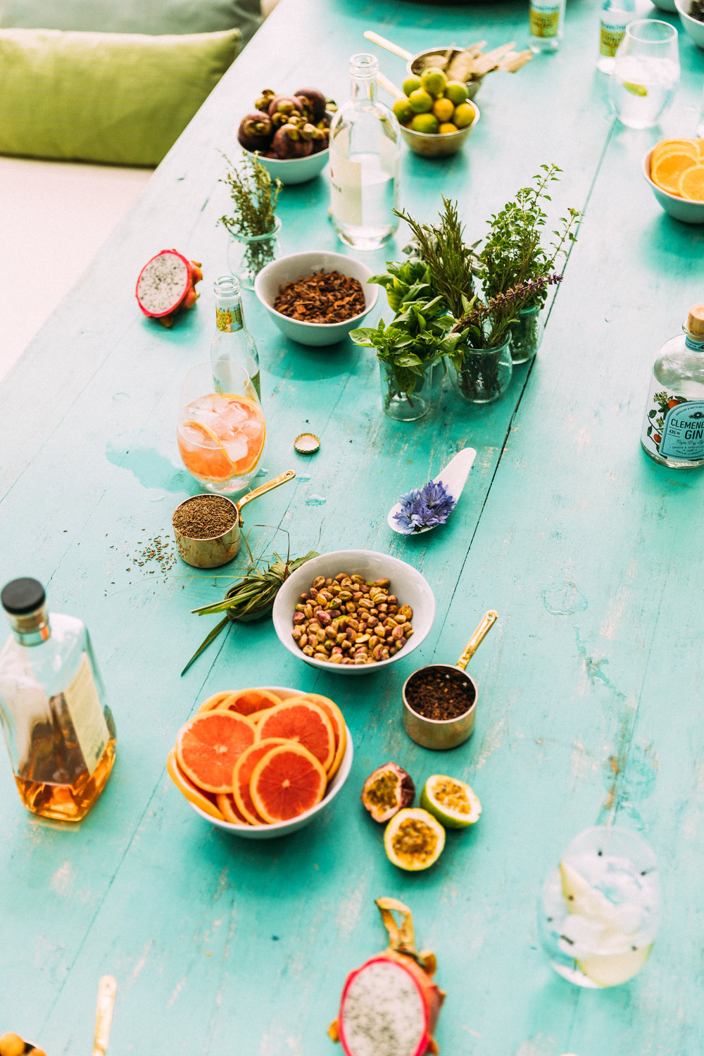 A bounty of beautiful ingredients adorn the table ready for a craft gin tasting on North Island, Seychelles