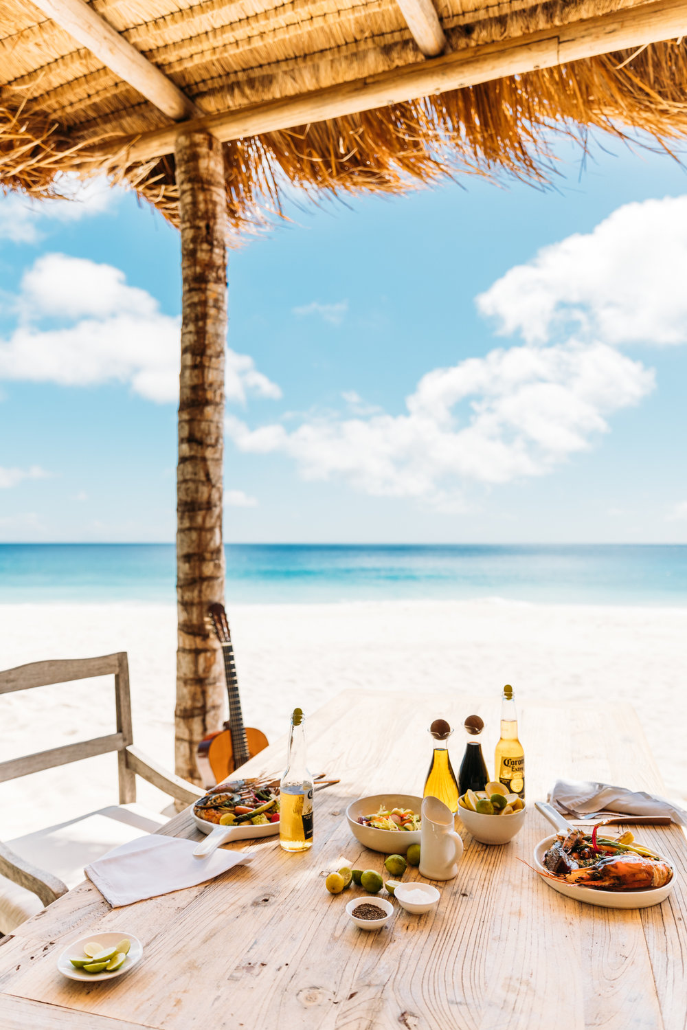 A seafood barbecue lunch is served with ice-cold Corona at West Beach Bar in Seychelles