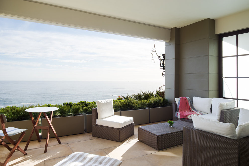 The large private terrace at 21 Nettleton's Queen Suite featuring comfortable outdoor seating with magnificent ocean views