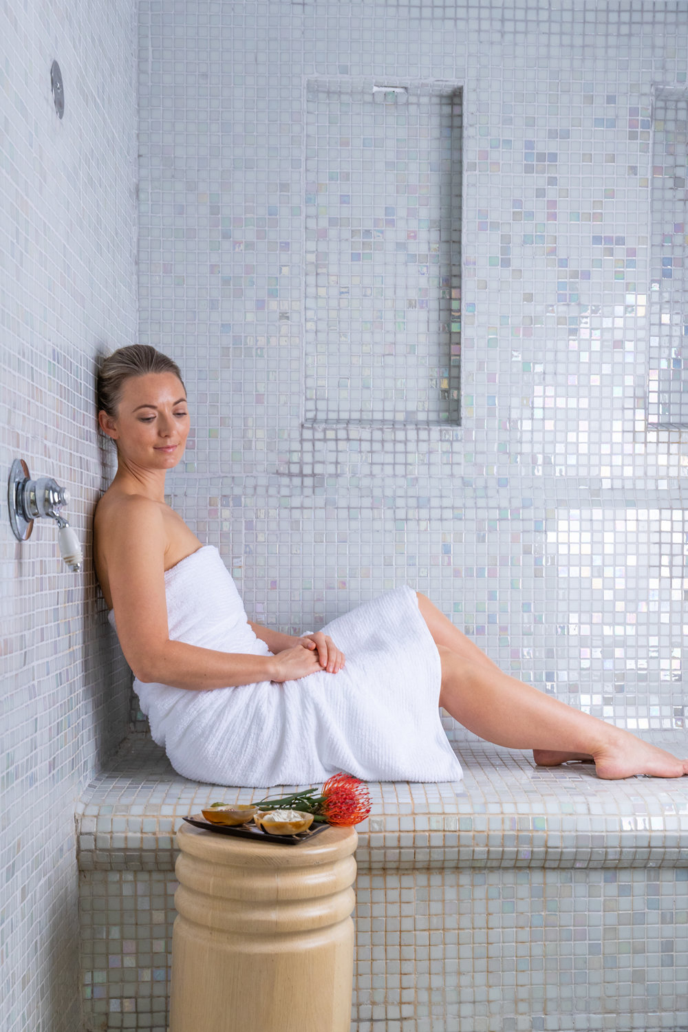 Girl relaxing in Swedish sauna and steam room at Delaire Graff Spa