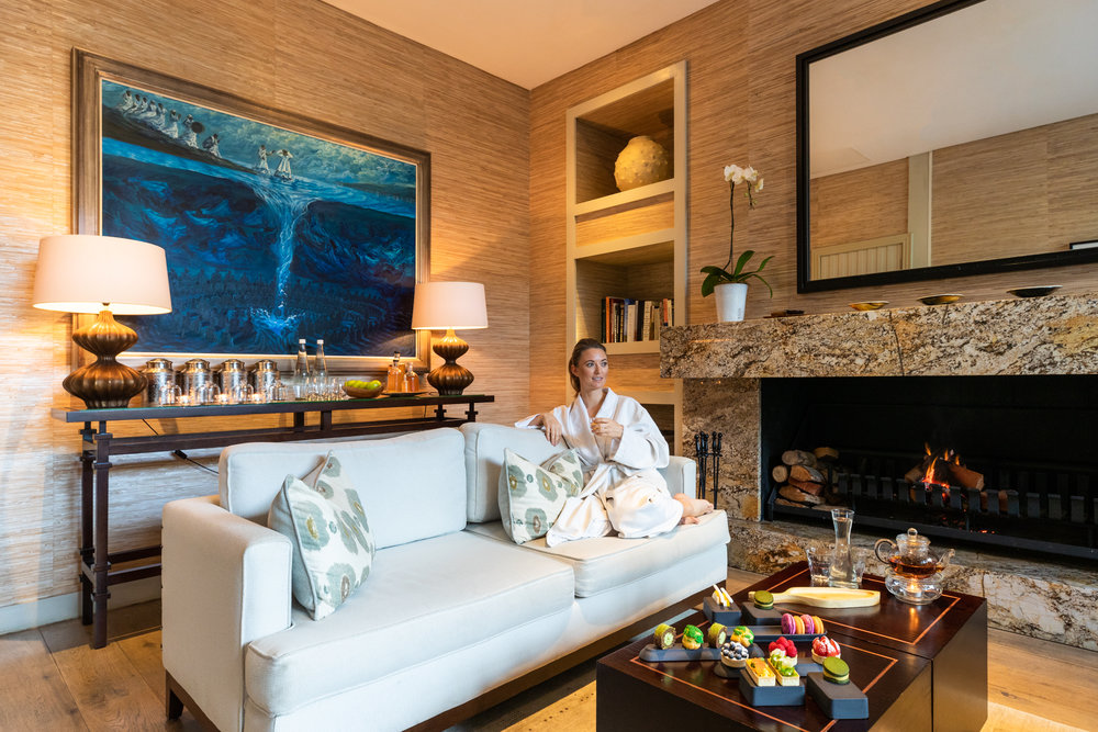 Girl enjoying an exclusive Afro-Asian high tea in the relaxation room at Delaire Graff Spa
