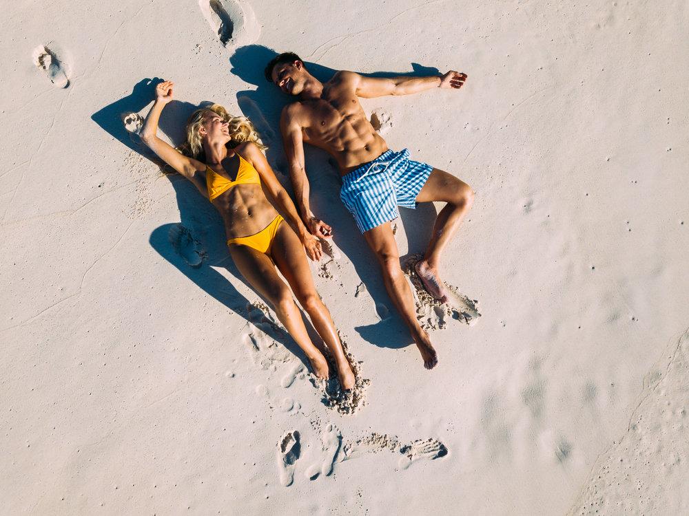North Island - Couple on West Beach - 2500px-2.jpg
