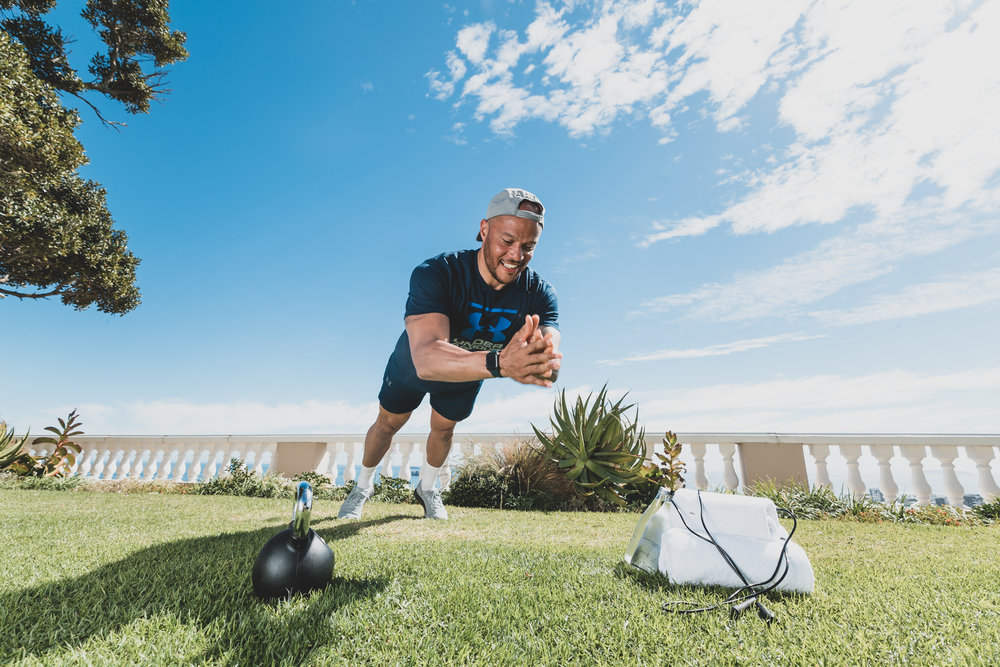 Harry Jameson doing push-ups on the lawn at Ellerman House.