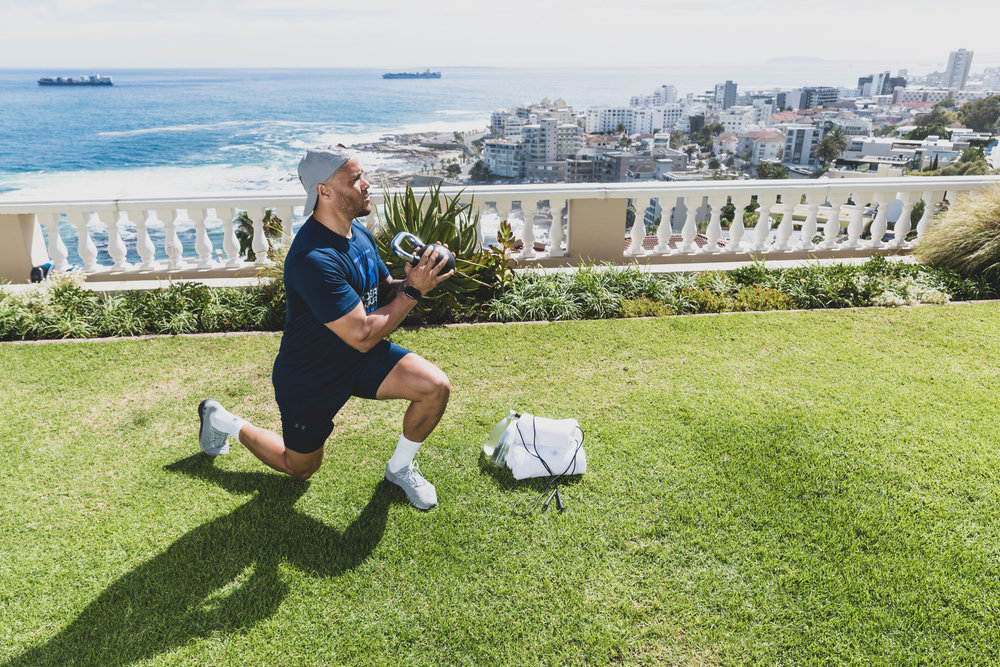 Harry Jameson performs kettle bell exercise along Atlantic Seaboard in Cape Town.