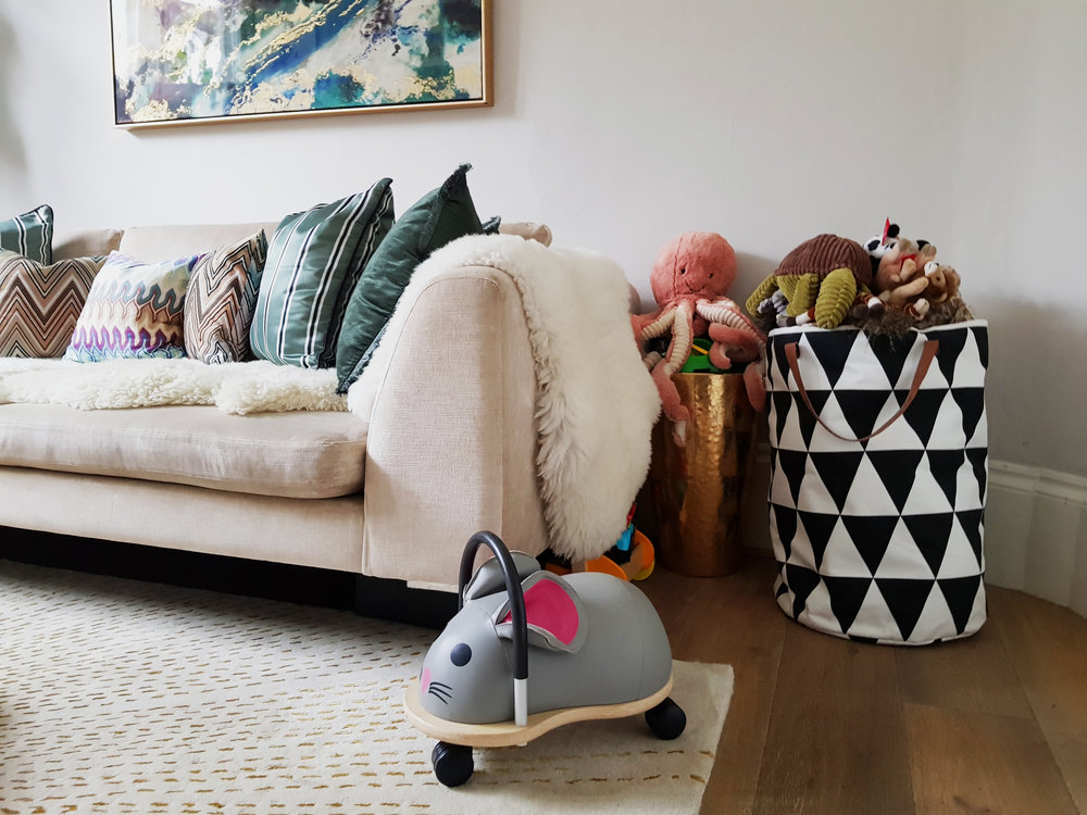 Behind the door a  Ferm Living  canvas basket is used for toy storage. Cushions from  Missoni Home .