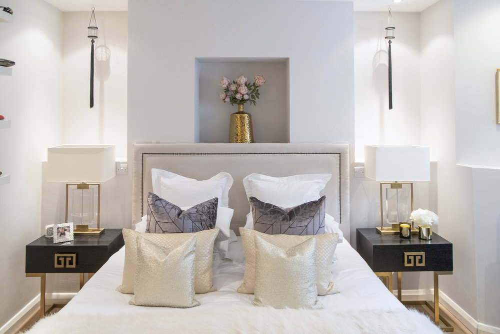 In the Master Bedroom, bed, bedside tables and lamps from the  Yohan May Boutique . Cushions made with a  Missoni Home  fabric. Candle from  Cire Trudon .