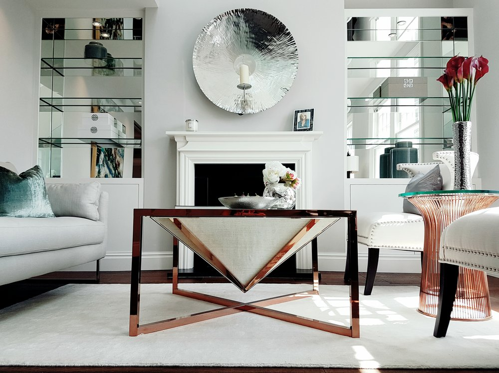 STYLING - Install custom mirrored panels to walls and enclaves – or hang decorative mirrors in the right places to help bounce light around the room. This not only gives you a brighter, lighter room it also creates the illusion of more depth.Luxurious Fulham Flat by Yohan May Interiors