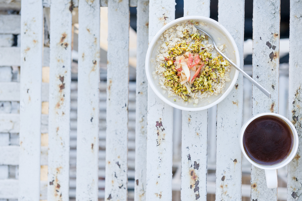 Coconut and Pear Bircher Muesli with Grated Apple and Crushed Pistachios. Vegan, Gluten free, Raw.