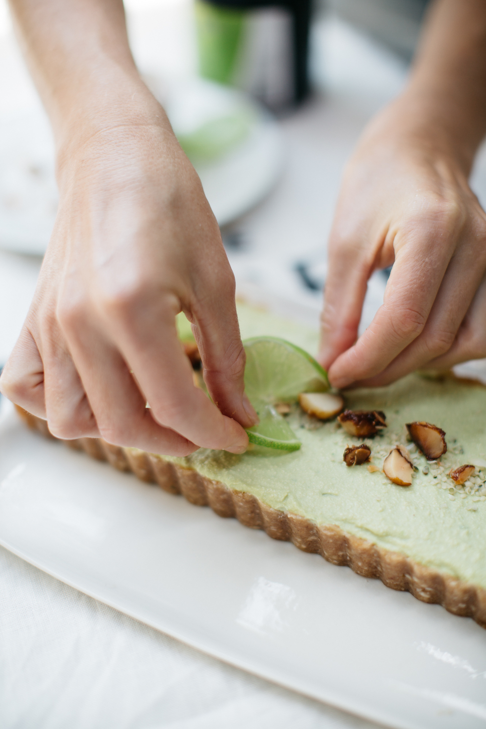 avocado key lime tart with candied macadamia nuts