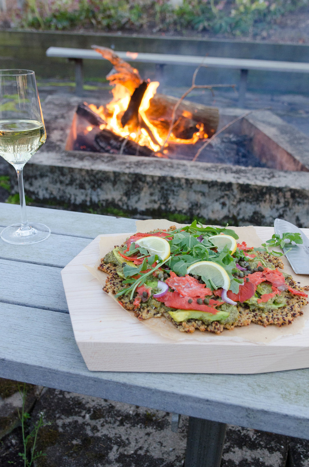 Quinoa Pizza with Smoked Salmon and Rocket Pesto recipe by Eat Real Food.