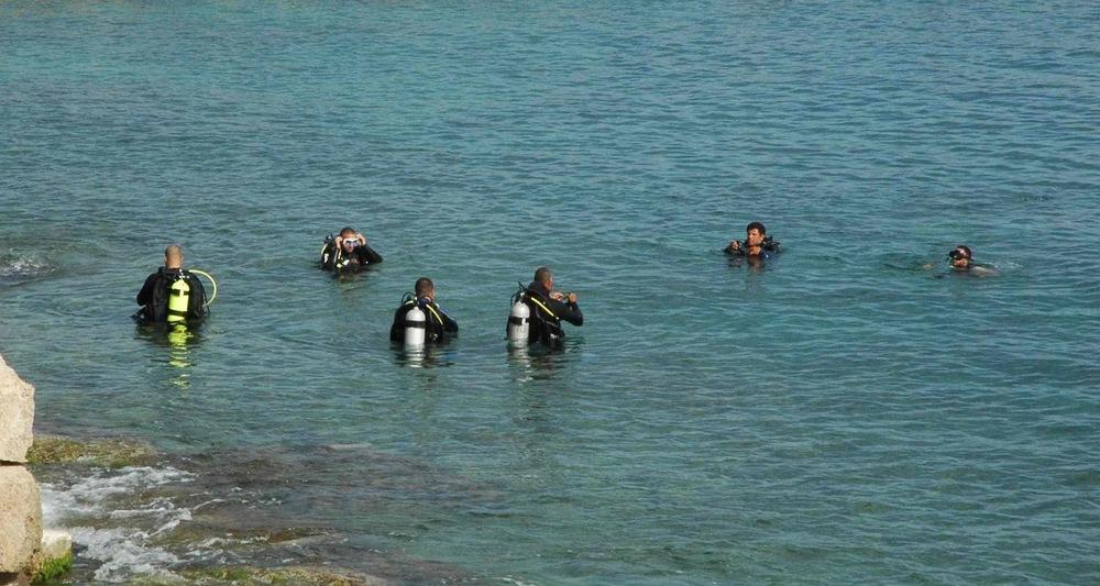 Divers prepare to descend to the remains of the Roman harbor at Caesarea Maritima, Israel.