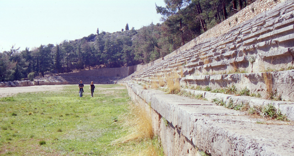 The tactile experience of walking across the Delphic Stadium by Tony Bivins and Jessica Rappe cannot be duplicated in the traditional classroom! Tony and Jessica were students at Boise Bible College when Mike Kennedy snapped this photo. Thanks to Mike for sharing this and other images from our Aegean Study-Tour, 2003.