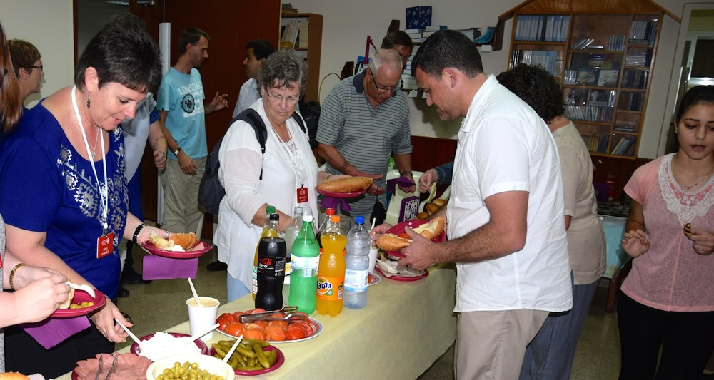 Believers from Galilee and New Zealand share food and fellowship. Photograph courtesy of Mike Taylor member of our 2014 Pilgrimage Tour of Israel-Palestine. Photo courtesy of Mike Taylor.