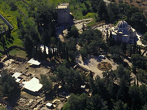 "Aerial view to the site. Image taken from the Al Quds University report found  here . The ""wheel"" shaped structure near the center of the picture is the fountain. Ruins, some covered, spread to the lower left. A modern chapel stands in the upper right."