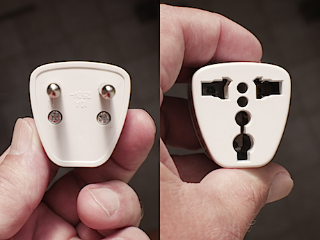 "Plug adapter. On left, the pegs go into the ""Screamer"" outlet. On right, your appliance plugs in here."