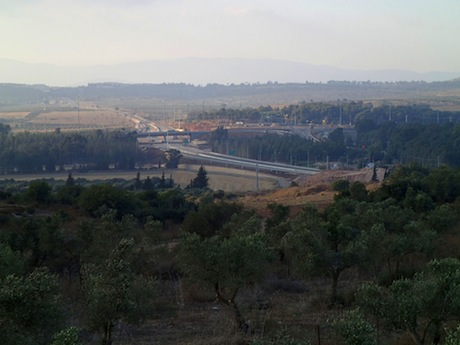 View to the new construction at the Golani Interchange in the Galilee. The McDonald's is on the far side of the highway; my campsite, in the trees on the right .