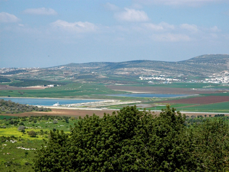 View to the Sahl al Battuf. An ancient mound (Tell Bedeiwiyeh) believed to be Hannathon from the Bible and the Amarna Letters is visible between the two water reservoirs. A fortified farmstead from the Crusader period rests atop the tell.