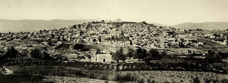 View to Suffuriyyah from the south. The large structure on the top of the hill is a Crusader-era fortress. It was used as a school by the local inhabitants. Source.