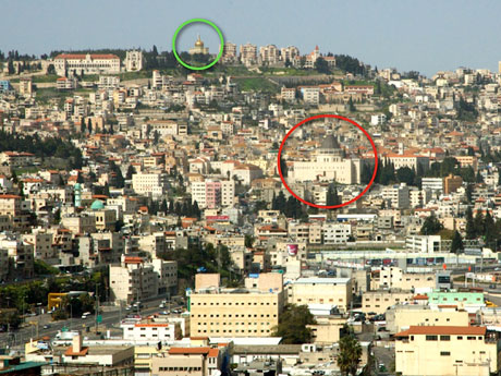 "The al-Nabi Sa'in mosque (inside the green circle) overlooks the city. It is flanked by Christian institutions and peers down upon the Church of the Annunciation (inside the red circle). This shot was taken from the far side of Nazareth's ""bowl"" on Mount Precipice (or Kedumim)."