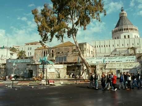 This view to the proposed mosque site was shot approximately two months before Pope John Paul's visit in the year 2000. Note the banners, flags, dome, and carpets.