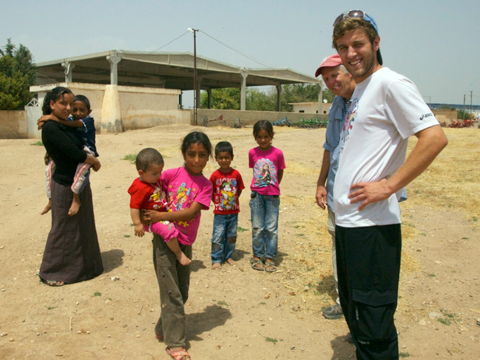 Tanner, Keith, and the village kids.