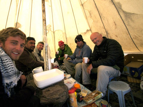 Elegant dining at 13,650 feet. From left to right: Tanner, Alcan, Greg, Uraz, Tommy, and Wilkerson. Note the boulder used as a table.