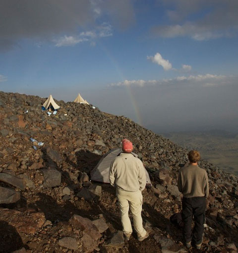 Keith and Tanner look at the rainbow over High Camp.
