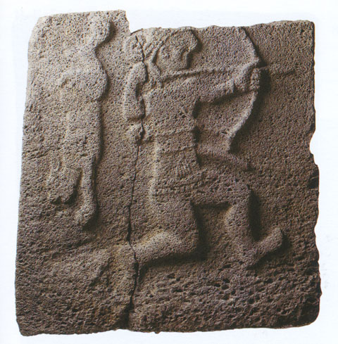 Bow hunter and rabbit on basalt relief found at Samal (Zincirli). On display at the Istanbul Archaeological Museum.