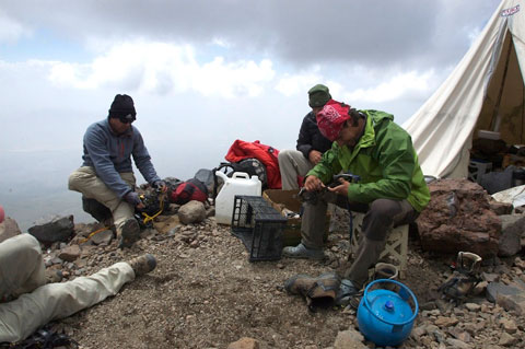 Uraz and the fellas in front of the tent, testing the fit of their crampons.