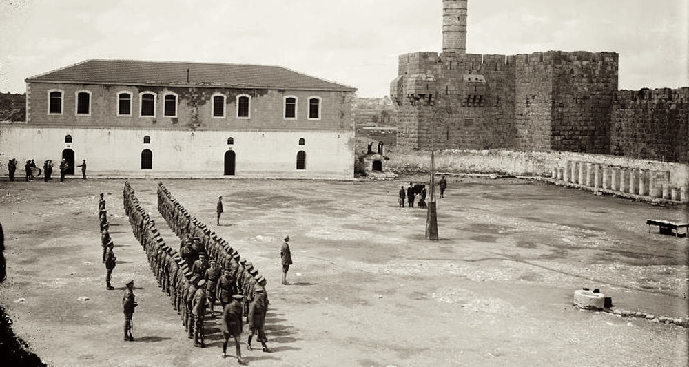 "Soldiers in Barracks Square on 19 March 1918. This image clearly shows the Kishle as a two story building with a tiled roof. Note its position just south of the ""Tower of David."" Image from  here ."
