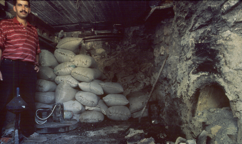 A dung-fired pottery kiln in central Palestine. The firebox is on the right. Sacks of dried dung line the walls.