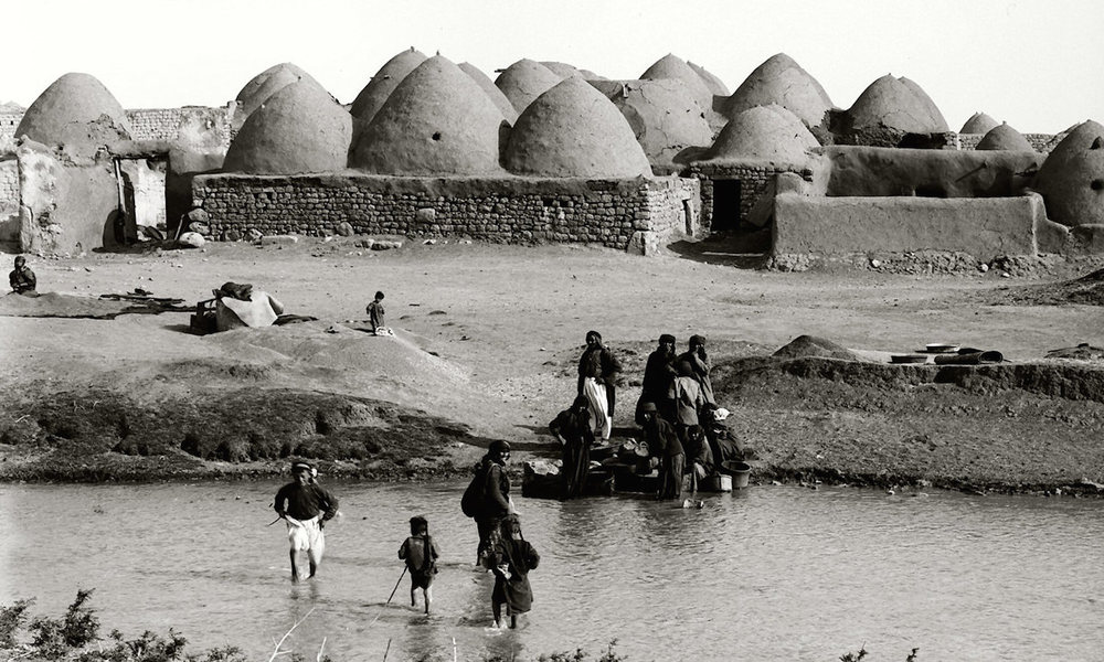 A cluster of beehive homes in Moselmeih, northern Syria. 20th century i  mage from the Matson Collection. See  here  for more information.