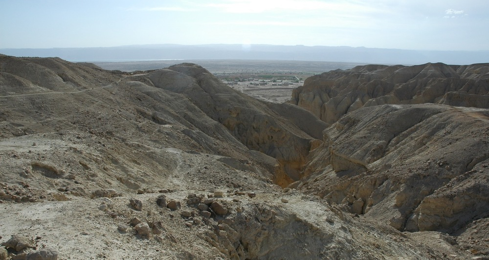 View to the remains of Bab edh 'Dhra in Jordan. Tom Schaub and Walt Rast led an American team of excavators working at this site in the 1970s and early 1980s. The waters of the Dead Sea are visible on the distant edge of the plain. The hills of Judea rise beyond.