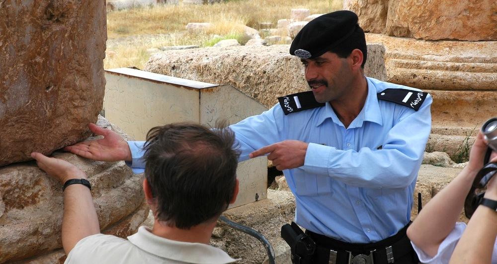 A Jordanian Tourist Policeman visits with a tourist. Jerash, Jordan.