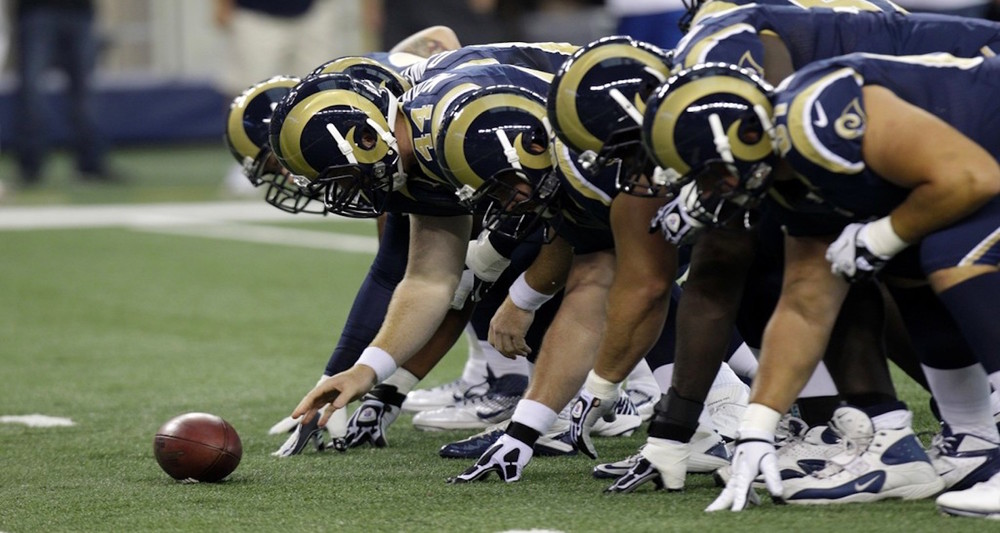 While not a fan of any St. Louis team (or Los Angeles, for that matter), I must admit that the Rams have the coolest uniforms in the NFL. Image from  here.
