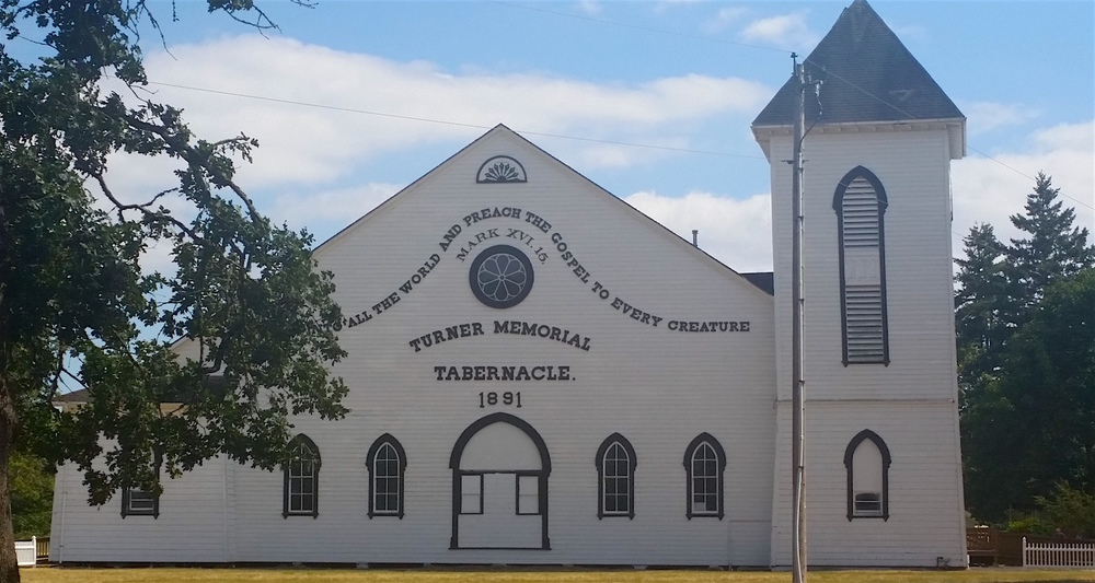The tabernacle today. It wears a fresh coat of white paint and black trim. Note the missing tower on the left.