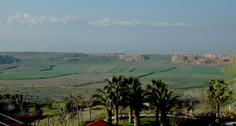 The snowcapped Aegean Blocks (Baba Dagh) rise in the sky. Note the palm trees   of Pamukkale (Turkey) near our feet.