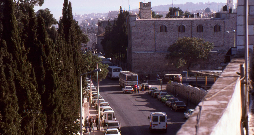 The view to the East Jerusalem Bus Station back in the day. Ecole Biblique is to the left, behind the trees. The Damascus Gate into the Old City is straight ahead.