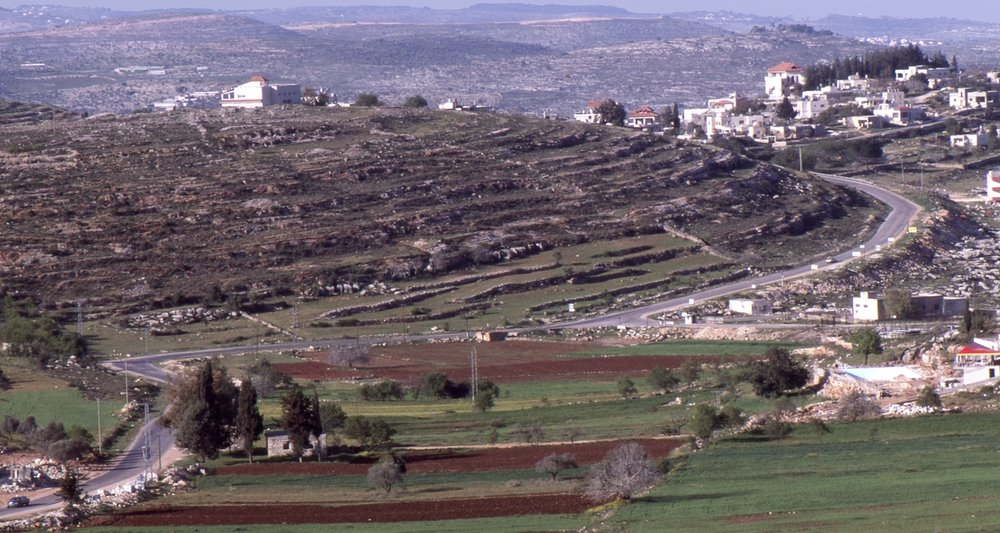 The road between Ramallah and Birzeit (Palestine) winds through naked hills and valleys.