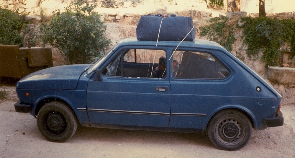 Here is the old Fiat 127, as good as new! After I crashed the fruit truck (another story, another day)I bought some paint and brushed the hood by hand. It was mostly blue.