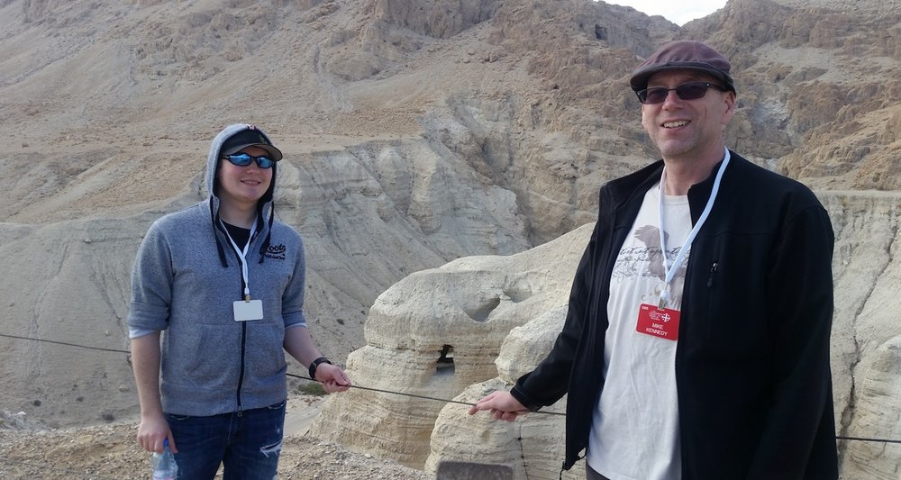 Mike with his son, Jimmy, visiting Qumran, Israel. Note the hand-hewn cave behind them. This is Cave 4, perhaps the most important of the Dead Sea scroll repositories.